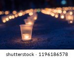 a group of candles burning in... | Shutterstock . vector #1196186578