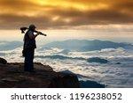 silhouette of man photographer... | Shutterstock . vector #1196238052