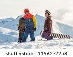 couple snowboarding freeriders... | Shutterstock . vector #1196272258