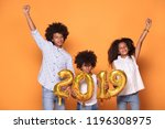 happy smiling three afro... | Shutterstock . vector #1196308975
