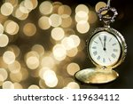 New Year Clock On Abstract...