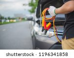young man charging battery car... | Shutterstock . vector #1196341858