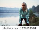 young woman leaning on her... | Shutterstock . vector #1196354548