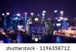 digital camera over tripod on... | Shutterstock . vector #1196358712