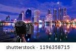 digital camera over tripod on... | Shutterstock . vector #1196358715