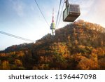 cable car and seoul tower with... | Shutterstock . vector #1196447098