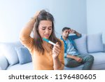 young woman sitting on the bed... | Shutterstock . vector #1196480605