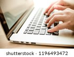 female hands on a laptop... | Shutterstock . vector #1196493472