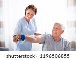 young female nurse helping... | Shutterstock . vector #1196506855