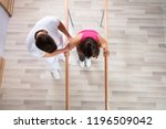 female patient being assisted... | Shutterstock . vector #1196509042
