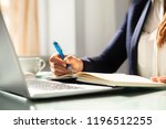 close up of a businesswoman's... | Shutterstock . vector #1196512255