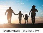silhouette of family running in ...   Shutterstock . vector #1196512495