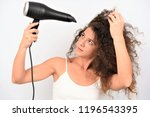 pretty young woman blowing her... | Shutterstock . vector #1196543395