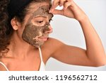 woman removing facial dried... | Shutterstock . vector #1196562712