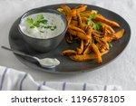 crispy sweet potato fries in...   Shutterstock . vector #1196578105