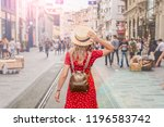 beautiful woman stands at... | Shutterstock . vector #1196583742