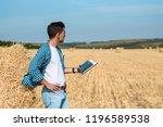 man farmer in jeans and shirt...   Shutterstock . vector #1196589538