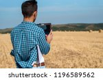 rear view young agronomist in...   Shutterstock . vector #1196589562