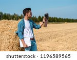 young agronomist in white t...   Shutterstock . vector #1196589565