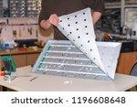 repair of modern tv set.... | Shutterstock . vector #1196608648