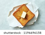 toast with margarine  | Shutterstock . vector #1196696158