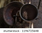 grinding the coffee in the... | Shutterstock . vector #1196725648