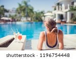 woman relaxing at the luxury... | Shutterstock . vector #1196754448
