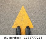 feet and arrows on road. | Shutterstock . vector #1196777215