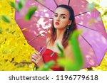 beautiful girl with umbrella in ...   Shutterstock . vector #1196779618