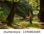 a fisherman fishing with fly...   Shutterstock . vector #1196802685