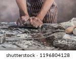 man preparing buns at table in... | Shutterstock . vector #1196804128