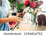 female florist holds fresh red... | Shutterstock . vector #1196816752