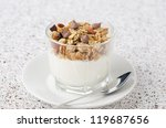Yogurt with muesli and chocolate drops in a glass beaker of portion - stock photo