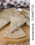 piece of bread from rye flour with dill closeup - stock photo