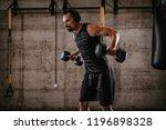 young muscular man doing hard... | Shutterstock . vector #1196898328