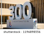 Vaduz, Liechtenstein, 16th August 2018:- A large 300 outside the national Parliment in Vaduz, celebrating Liechtenstein's national day and 300 years of independence - stock photo