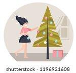 girl decorating christmas tree. ...   Shutterstock .eps vector #1196921608