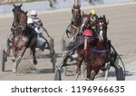 Small photo of Palma de Mallorca / Spain - May 22, 2016: Riders compete during their harness racing or horse sulky race in Palma de Mallorca hippodrome at the Balearic islands Sulky races trophy
