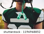closeup of a mouthguard hanging ... | Shutterstock . vector #1196968852