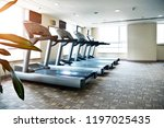 group of treadmills in modern... | Shutterstock . vector #1197025435