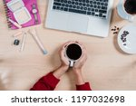 woman hand's holding cup of... | Shutterstock . vector #1197032698
