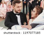 bride and groom making oaths ... | Shutterstock . vector #1197077185