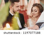 bride and groom making oaths ... | Shutterstock . vector #1197077188