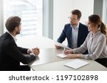 two hr managers talking with... | Shutterstock . vector #1197102898