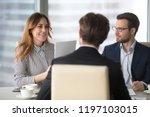 young broker businesswoman... | Shutterstock . vector #1197103015