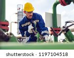 oil worker is turning valve on...   Shutterstock . vector #1197104518