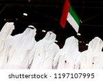 emirati men looking at the uae... | Shutterstock . vector #1197107995