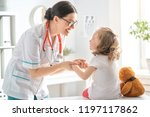 doctor examining a child in a... | Shutterstock . vector #1197117862