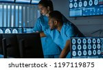 two medical scientists  ...   Shutterstock . vector #1197119875
