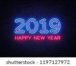 2019 happy new year neon text.... | Shutterstock . vector #1197127972
